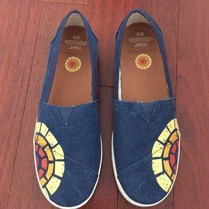 Toms blue slip on sun detail shoes. NWOT size 10